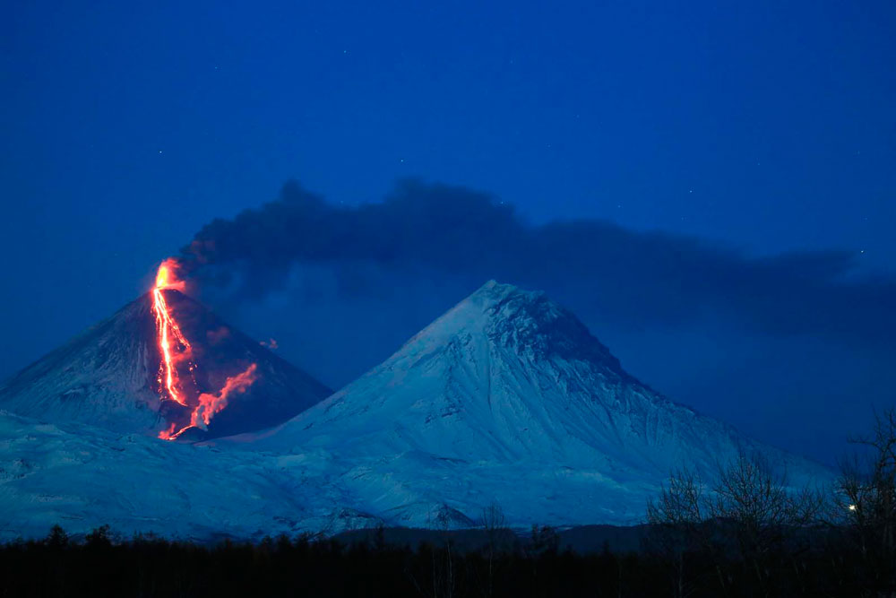 Klyuchevskaya volcano at night. In the foreground - Volcano Kamen