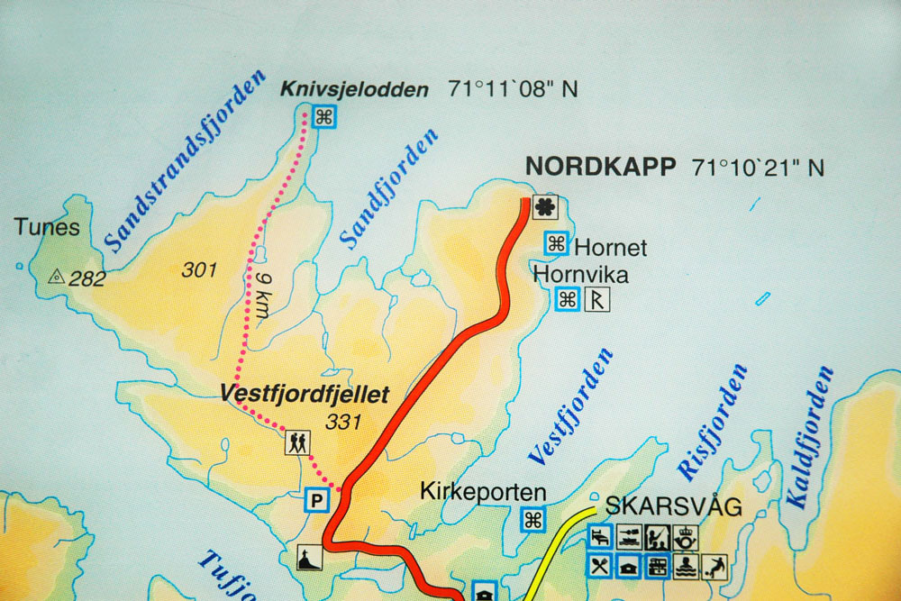 The road to the Nordkapp and the path to the cape Knivsjelodden on the Norwegian map