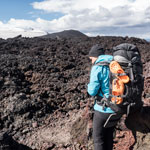 Travel around Iceland. Go through the lava fields of the volcano Eyjafjallajokull