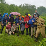 Great Kamchatka trip. Joint photo of two groups in a rainy Nalychevsky forest