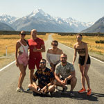 Traveling in New Zealand. Our group on the background of Mount Cook
